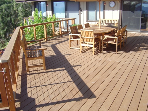 Mouser inc decking built to last for Cost of composite decking vs pressure treated